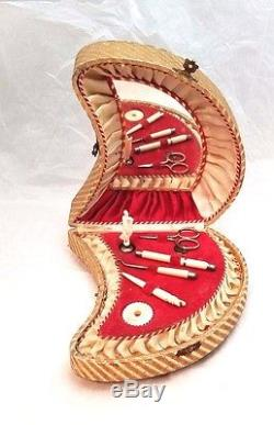Antique sewing music box with spinning woman with tools, circa 1900s